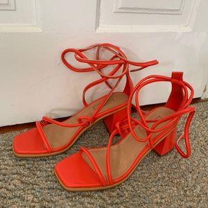 Bright orange lace-up sandals